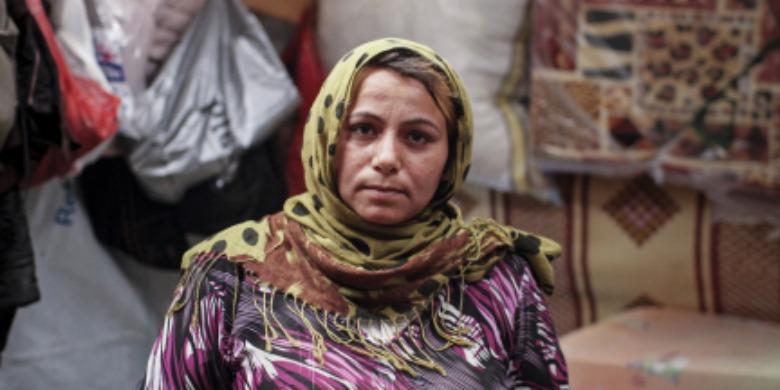 Bouchara är 27 år gammal och mor till tre barn. Här är hon fotograferad i ett tältläger för syrianska flyktingar i Bekaadalen i Libanon i juli 2014. Foto: European Commission DG Echo/Flickr
