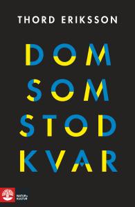 """Bokomslag. Titeln """"Dom som stod kvar"""" står skrivet med blågul text."""