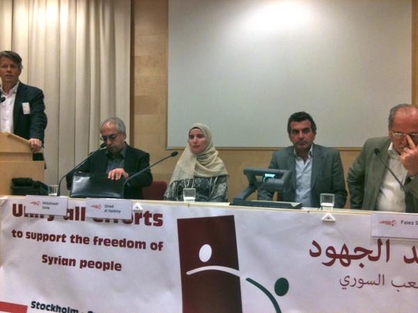 Jens Orback, Abdulbaset Sieda, Ghied Al Hashmy, tolk, Faiez Sara. Bild: Dagens Arena